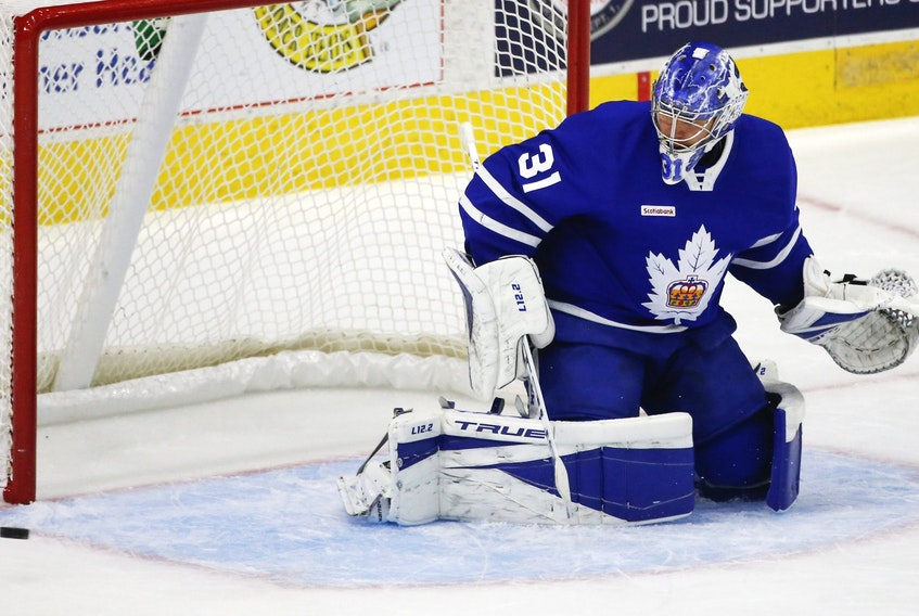 Goalie Frederik Andersen makes a toe save during his conditioning stint with the AHL's Marlies in Toronto on Thursday, May 6, 2021.