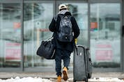 A traveller arrives at the mandatory quarantine Alt Hotel near Toronto's Pearson Airport during the COVID-19 pandemic, Monday February 22, 2021.