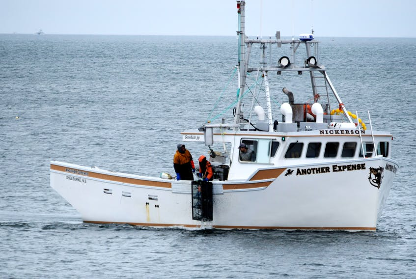 A lobster trap is hauled aboard the fishing vessel Another Expense during a day on the fishing grounds near the Woods Harbour coastline. The six-month commercial lobster  fishery is southwestern Nova Scotia and the South Shore closes on May 31. KATHY JOHNSON
