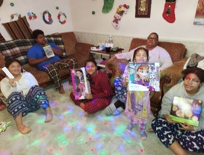 The Boddie family was thankful to be sponsored at Christmastime as it gave the kids something to look forward to after watching firefighters battle a blaze at their home just a few months prior. - Contributed