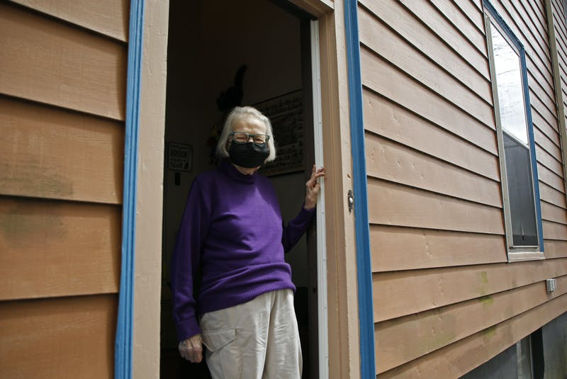 Brenton Street resident Maggie Grice stands in the doorway of her Halifax home on Wednesday. She has been hit several times outside her home by projectiles from a pellet gun. - Tim  Krochak