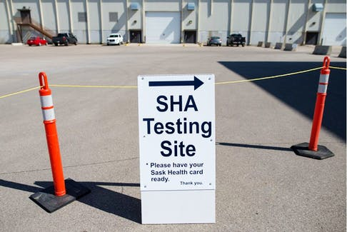 A sign marks the entry at the Saskatchewan Health Authority drive-thru COVID-19 testing facility in Regina.