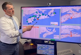 Island Recruiting president Blake Doyle presents labour market data to his team in Charlottetown using predictive analytics software.