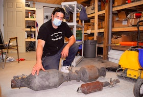 Peter Arapis, owner of Cape Breton Salvage and Parts Inc. in Gardiner Mines, shows a Dodge diesel catalytic converter worth about $2,000 and a smaller one from a GM Grand Am worth about $400. The purchasing of these parts is a major part of his business. Police say there are spikes in thefts of these parts when the market for the precious metals inside catalytic converters is high. Sharon Montgomery-Dupe • Cape Breton Post