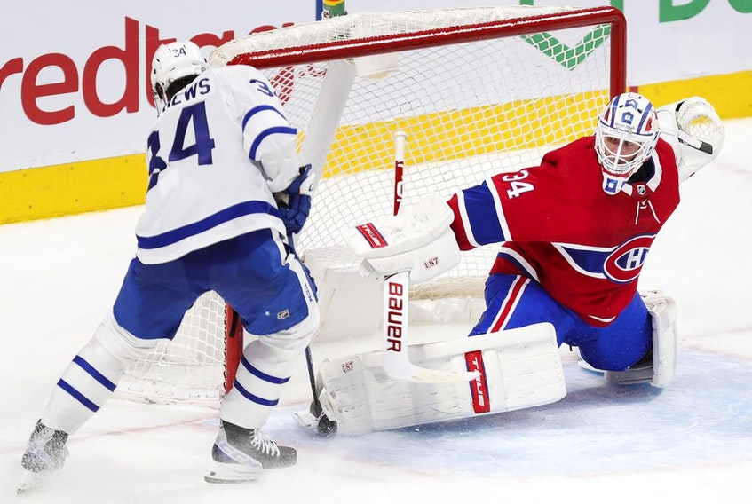 Montreal Canadiens' Jake Allen stops Toronto Maple Leafs Auston Matthews on a breakaway during overtime in Montreal on May 3, 2021.