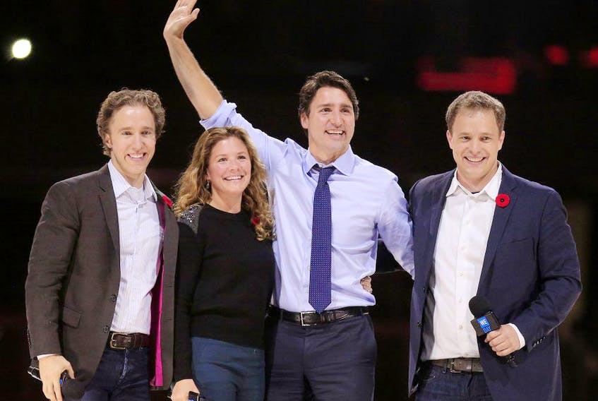 Prime Minister Justin Trudeau and his wife, Sophie, are flanked by We Day co-founders Craig Kielburger, left, and his brother Marc, during a WE Day event in Ottawa on Nov. 10, 2015.