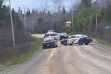 Cape Breton Regional Police with the Beechmont Road cordoned off in Gillis Lake Thursday afternoon while looking for an individual regarding a complaint of threats.