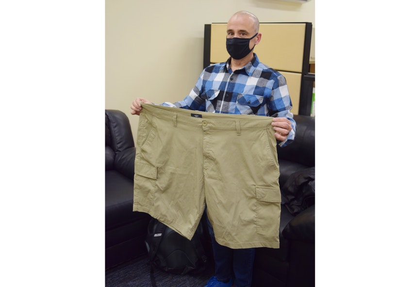 Don Gunton holds a pair of shorts that he used to wear. - Adam MacInnis