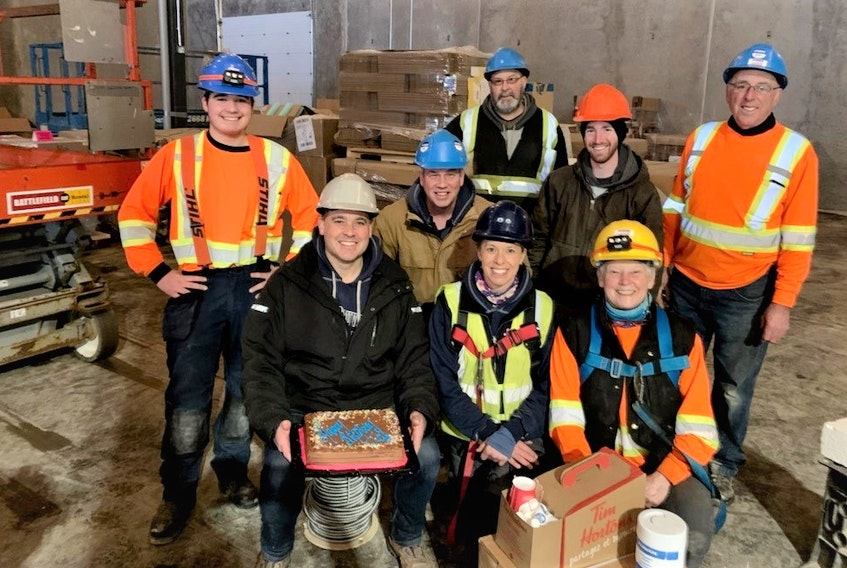 The Jeff Deuville Electrical Ltd. work family, which includes a number of immediate family members, coming together on a job site recently to celebrate Jeff's birthday. Pictured are Jeff (front, left) with his cake, Andy Deuville, Lorraine Deuville, Brett Deuville (centre, left), Dale Spinney, Mitchell Ellsworth, Owen Deuville and (back) John Doyle. Unavailable for photo was Jeff's wife Erin.