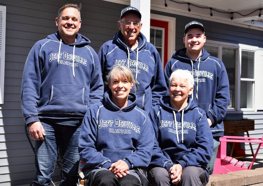 Displaying their Jeff Deuville Electric Ltd. sweatshirts are Deuville family members Jeff (back, left), Owen, Brett, Andy and Lorraine. - Richard MacKenzie
