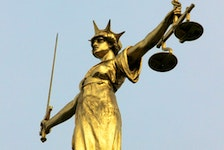 FILE PHOTO: A statue representing the scales of justice.