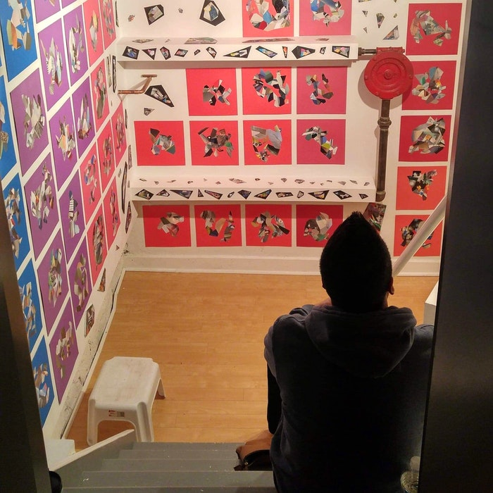 Korey Steckle looking at his art on display at a past exhibit. CONTRIBUTED