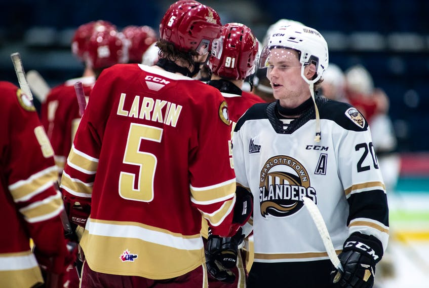Acadie-Bathurst Titan defenceman and Mermaid native Cole Larkin, left, shakes hands with Charlottetown Islanders winger and Charlottetown native Thomas Casey following Tuesday's final game of the Quebec Major Junior Hockey League's Maritimes Division final in Shawinigan, Que.