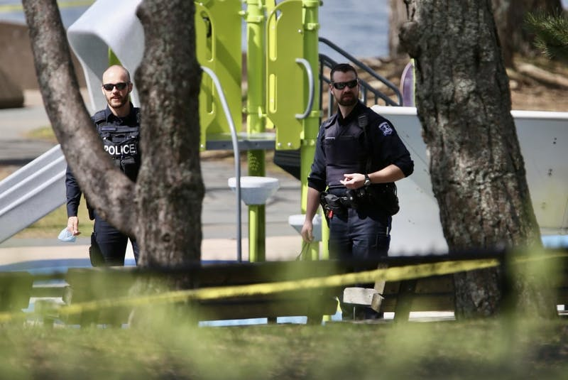 Halifax police officers walk past playground equipment near the scene of a fatal shooting at Alderney Landing in Dartmouth on Thursday, May 5, 2021. The shooting that happened the previous evening left a 22-year-old man dead. - Tim  Krochak