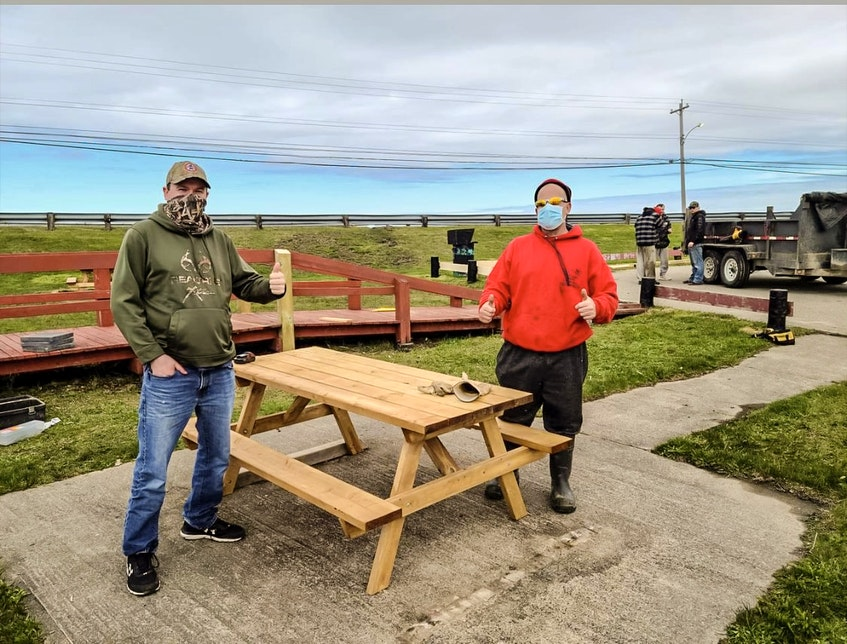 Port Morien Wildlife Association president Jeff McNeil with Donald Campbell Jr., owner of That's Right Roofing, at New Waterford Fish and Wildlife Park, in River Ryan, N.S. CONTRIBUTED