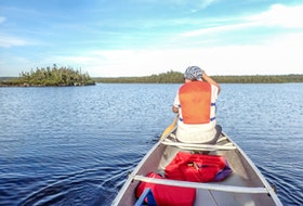 A canoe is dandy for trouting with family.