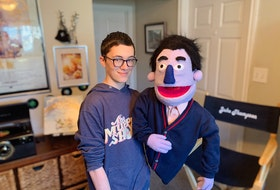 "Jake Thompson with puppet and retired TV personality, Gary Wheeseltin. Thompson has been fascinated by The Muppet Show since he was a child and began making his own puppets as he got older, eventually creating characters and his own YouTube channel. His new show ""The Adventures of Gary and Lou,"" written by Jake and Pete Soucy, is tentatively scheduled to air on Bell's Fibe TV this fall."