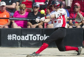Canada's Emma Entzminger fouls off a pitch against Mexico in a WBSC softball America's qualifier for the Tokyo Olympics, at Softball City in Surrey on Aug. 31, 2019.