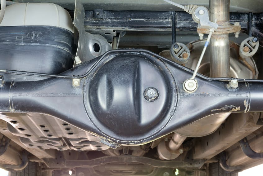 Checking the level and condition of axle and transfer-case fluids should be a part of every engine oil change service. 123rf stock photo