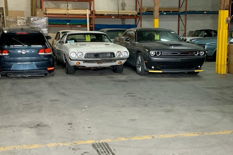 A warehouse full of classic cars destined for shipment overseas. Alyn Edwards/Postmedia News - POSTMEDIA