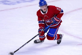 Montreal Canadiens' Cole Caufield skates with the puck during overtime against the Edmonton Oilers in Montreal on May 10, 2021.