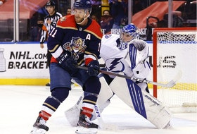 Jonathan Huberdeau of the Florida Panthers looks for a pass in front of goaltender Andrei Vasilevskiy of the Tampa Bay Lightning at the BB&T Center on May 8, 2021, in Sunrise, Fla.