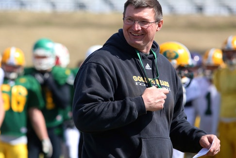 University of Alberta Golden Bears football head coach Chris Morris has a laugh during the team's annual spring training camp at Foote Field in Edmonton on April 27, 2014.
