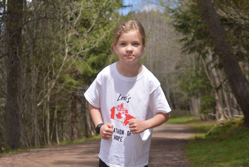Lexi Barbour doing her imitation of how Terry Fox held his arms while running in his Marathon of Hope. HARRY SULLIVAN - TRURO NEWS