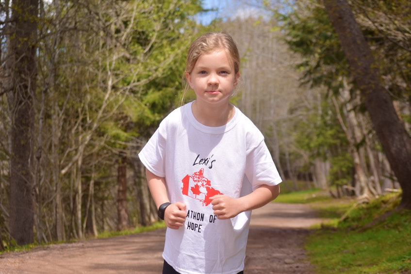 Lexi Barbour doing her imitation of how Terry Fox held his arms while running in his Marathon of Hope. - Harry Sullivan