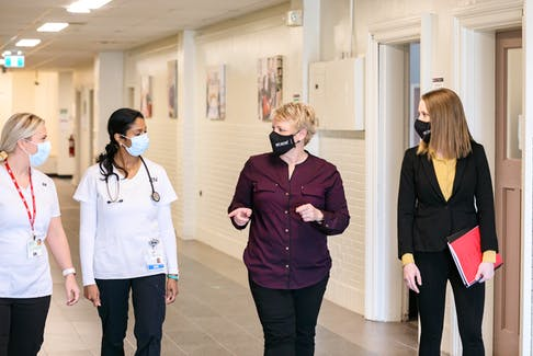 Barbara Brookins, second from right, president of the P.E.I. Nurses Union, says the nursing profession has grown more complicated over the years. Here she is pictured talking to two registered Island nurses and Stephanie Gallant, right, executive director of the nurses union.