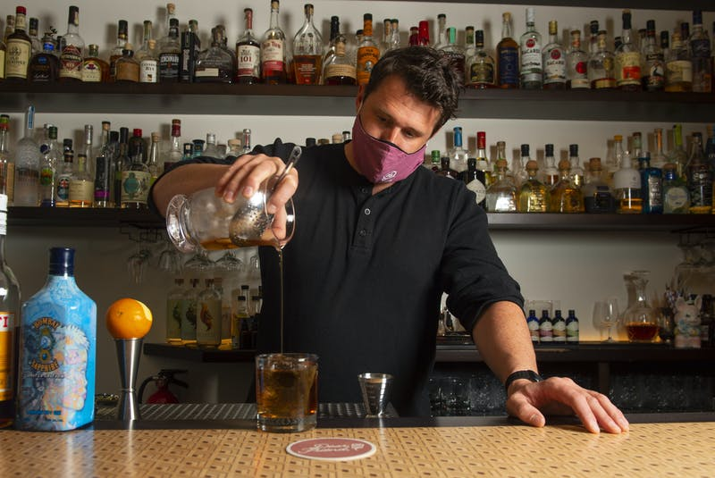 Jeff Van Horne, co-owner of the Clever Barkeep and Dear Friend, makes a Point Blank inside the cocktail bar on Portland Street in Dartmouth on Friday, May 14, 2021. Van Horne and business partner Matt Boyle want the provincial government to allow the sale of to-go cocktails for curbside pickup and delivery. - Ryan Taplin