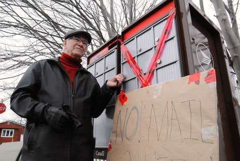 Anne Jeannette Trailer Park resident Samuel Johnson raised a community mailbox concern affecting him and 11 other residents of the Green Street area Thursday. The master lock was broken for a couple weeks until his mini protest led to it being fixed Friday. -Joe Gibbons/The Telegram