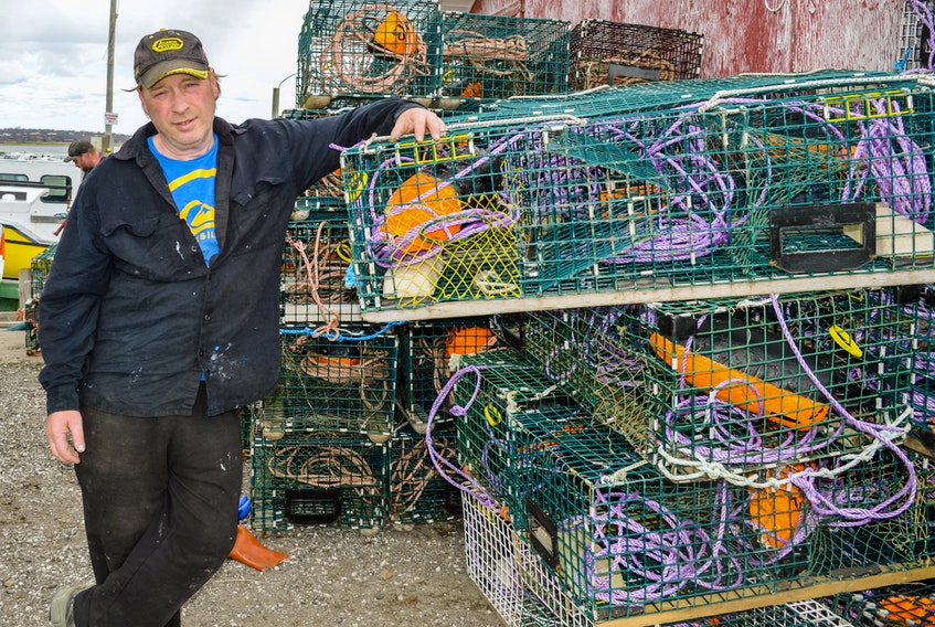 Fisher George Fraser helps prepare the lobster traps in South Baron Friday afternoon for early Saturday morning, the start of the lobster season in Area 27. JESSICA SMITH/CAPE BRETON POST