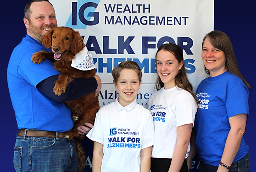 Beth House, right, Alzheimer society co-ordinator of education, support and outreach, and her family, husband Todd, children Nicholas and Becca and dog Rory, will all participate in this year's virtual fundraiser, Walk Your Way In May. Contributed