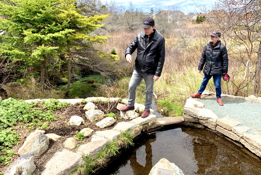 Geoff Kearley and Elizabeth Kearley, members of the Chamberlains Park Action Committee, walk on the trail in the park frequently to ensure it's maintained.