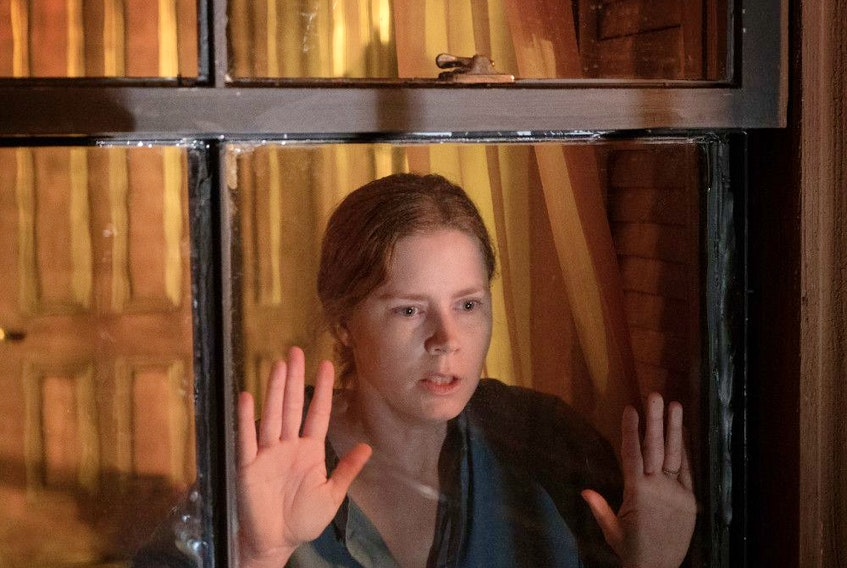 Amy Adams, just where you'd expect her to be, in The Woman in the Window.