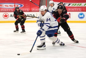 Toronto Maple Leafs centre Auston Matthews moves the puck past Ottawa Senators defenceman Nikita Zaitsev Wednesday in Ottawa as the regular season winds down.