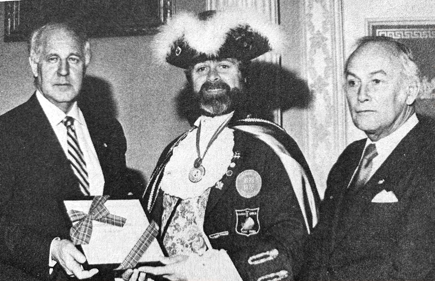 Lloyd E. Smith, Windsor's town crier, received a community service award from the Province of Nova Scotia in 1986 in recognition of his valuable contribution to improving the quality of life in his community. Pictured presenting the award were Premier John Buchanan and Minister of Health Ron Russell. - File Photo
