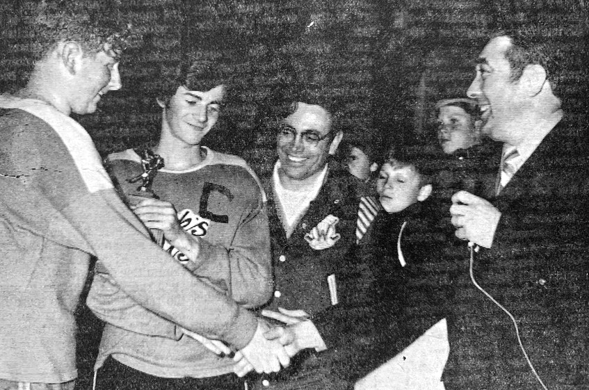 The Valley Jets' co-captains, Fred Babineau and Howie Mason, alongside their coach, George Cudmore, were all smiles when they accepted the 1971 trophy for the midget division from past-president Bob Brookes. - File Photo