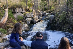 Heather Fegan's family enjoys the waterfall on the Long Lake Provincial Park Pipeline Trail.