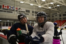 Carly Gould, left, of We'koqma'q and Nevaeh Doucette of Membertou were joking around on the ice at the Membertou Sport and Wellness Centre in February as part of the Female Indigenous Hockey Program aimed at bringing more opportunities for Indigenous girls to join hockey. Hockey Nova Scotia announced it will make changes to make the game more welcoming for historically marginalized groups. ARDELLE REYNOLDS/CAPE BRETON POST