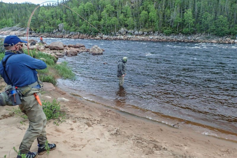 Salmon anglers cast their lines on a river in Newfoundland and Labrador. - File photo