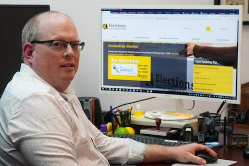 Tim Garrity, chief electoral officer with Elections P.E.I., visits the organization's website at his office in Charlottetown on May 14.