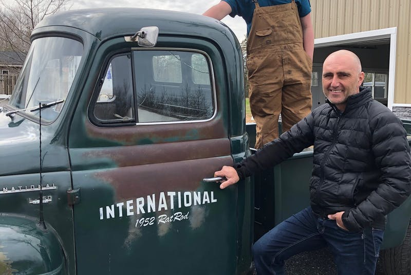 Gerry Foote, standing, with his son Chandler in the back, shows off his 1952 International pickup truck. While the cab itself is original, it was restored to its former glory thanks to a set of Jeep wheels and a chassis from the 1980s. Foote wanted to keep some of that rustic look, however, so maintained the rusted door and cracked window on the driver's side. - David MacDonald