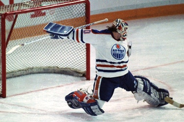 Edmonton Oilers goalie Bill Ranford makes a point-blank toe save off of the Winnipeg Jets' Moe Mantha during Game 2 of the Smythe Division semifinals at Northlands Coliseum in Edmonton on April 6, 1990. The Oilers went on to win the series in seven games and then beat the Boston Bruins in five games to win their fifth Stanley Cup.
