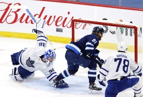 Jets winger Kyle Connor dekes Leafs goaltender Jack Campbell in the second period at Bell MTS Place on Friday night.