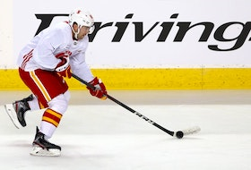 Flames winger Dominik Simon skates with the puck during practice at the Saddledome. Brendan Miller/Postmedia