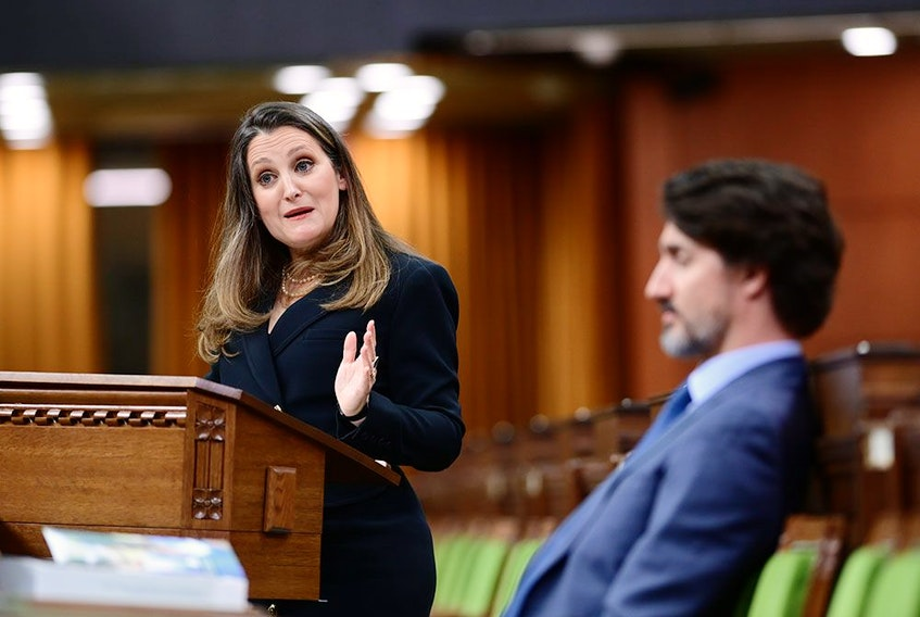 Finance Minister Chrystia Freeland delivers the federal budget in the House of Commons as Prime Minister Justin Trudeau listens, in Ottawa on April 19, 2021.