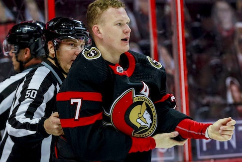 Ottawa Senators left wing Brady Tkachuk (7) heads to the penalty box after fighting with Vancouver Canucks centre Zack MacEwen (71) during first-period NHL action at the Canadian Tire Centre on Wednesday, April 28, 2021.