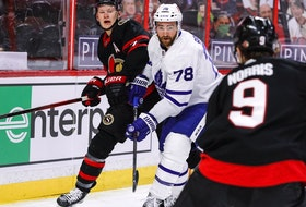 Ottawa Senators left wing Brady Tkachuk (7) and Toronto Maple Leafs defenceman T.J. Brodie keep their eyes on the puck in the first period on May 12, 2021.